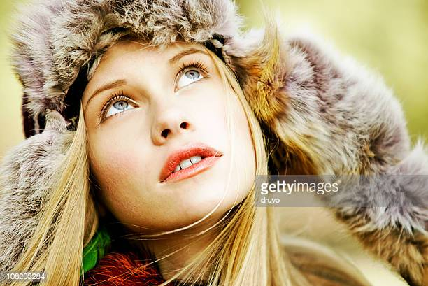 Portrait of Young Woman Wearing Fur Hat