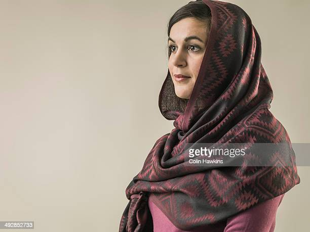 Portrait of young woman wearing hijab head scarf