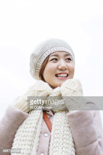 Portrait of young woman wearing knit hat : Stock Photo