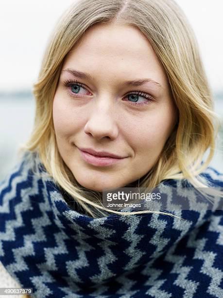 Portrait of young woman wearing muffler