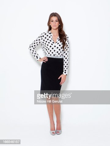 Portrait of young woman wearing spotted blouse