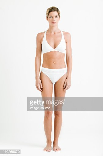 Portrait of young woman wearing white underwear