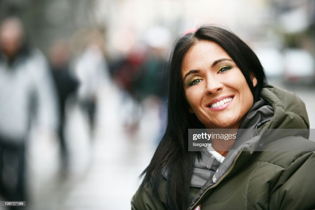 Portrait of Young Woman Wearing Winter Jacket Outside : Stock Photo