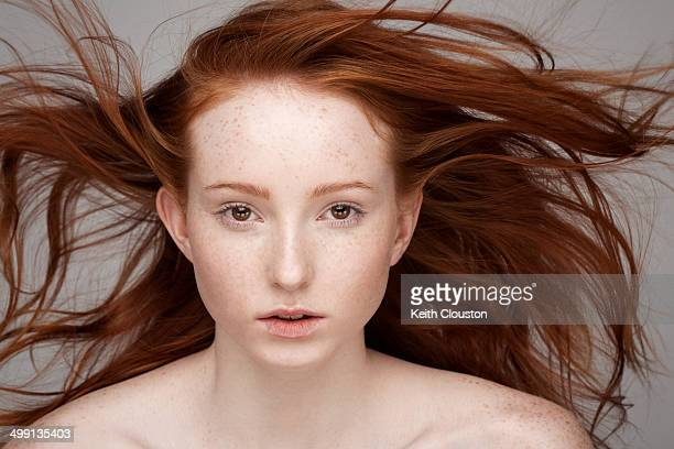 Portrait of young woman, windswept hair