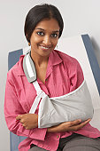 Portrait of young woman with arm in sling