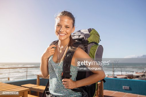 Portrait of young woman with backpack : Stock-Foto