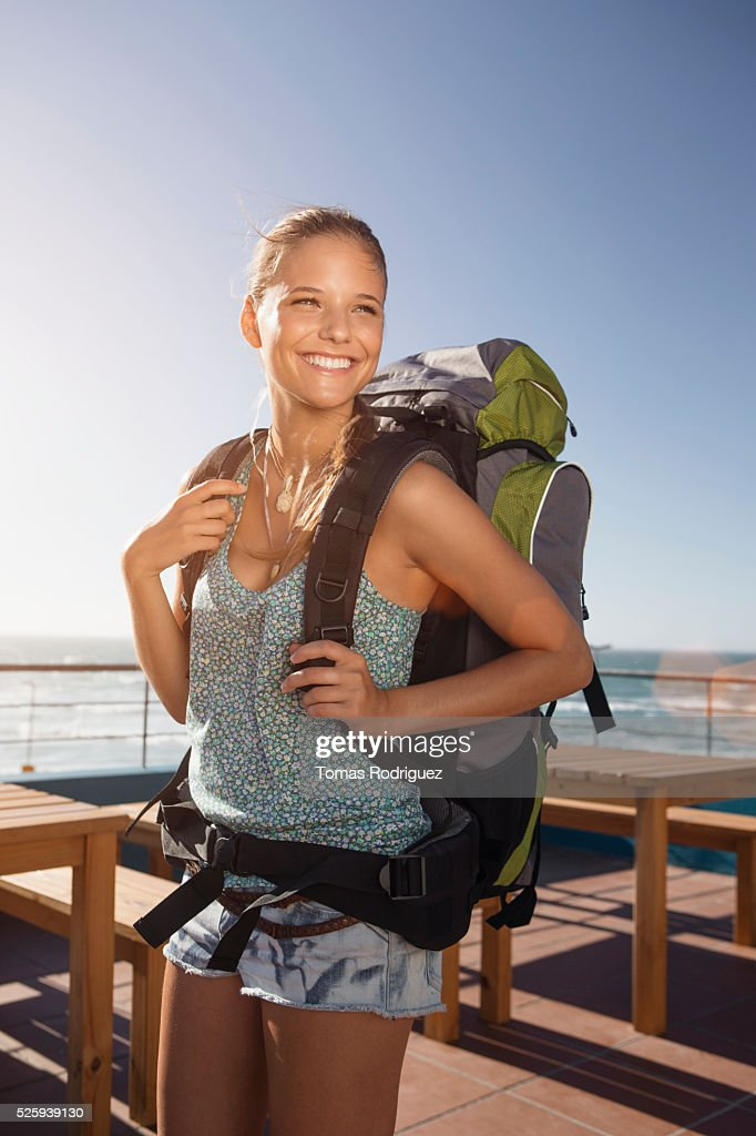 Portrait of young woman with backpack : Stockfoto