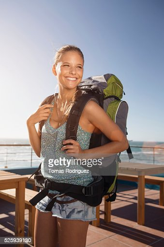 Portrait of young woman with backpack : Stock Photo