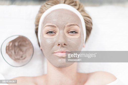 Portrait of young woman with beauty mask