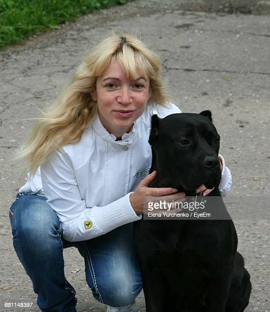 Portrait Of Young Woman With Cane Corso Dog