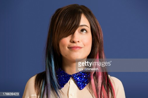 Portrait of young woman with dyed hair and blue sequin collar
