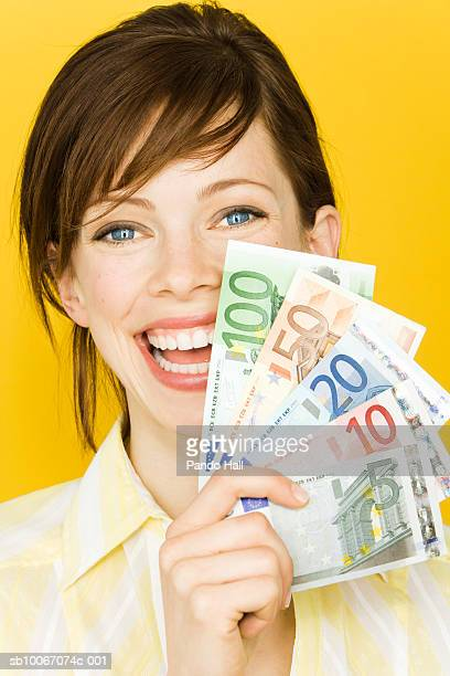 Portrait of young woman with Euro banknotes