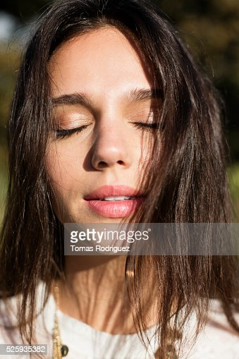 Portrait of young woman with eyes closed : Stockfoto