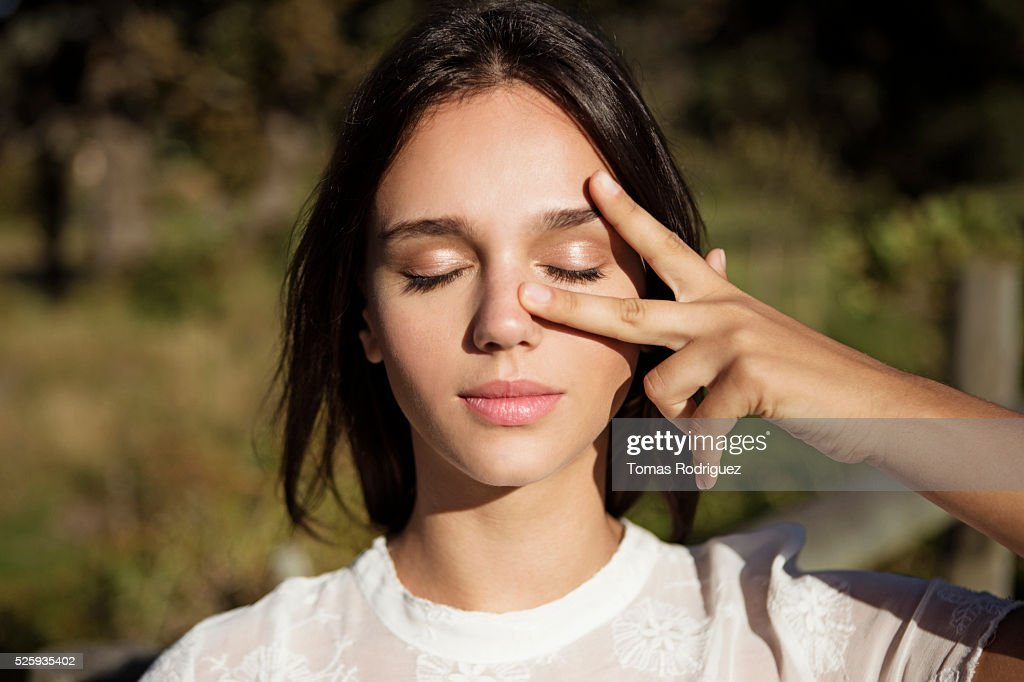 Portrait of young woman with eyes closed : ストックフォト
