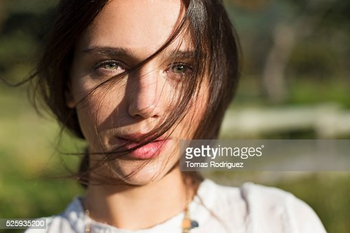 Portrait of young woman with hair on face : Stock-Foto
