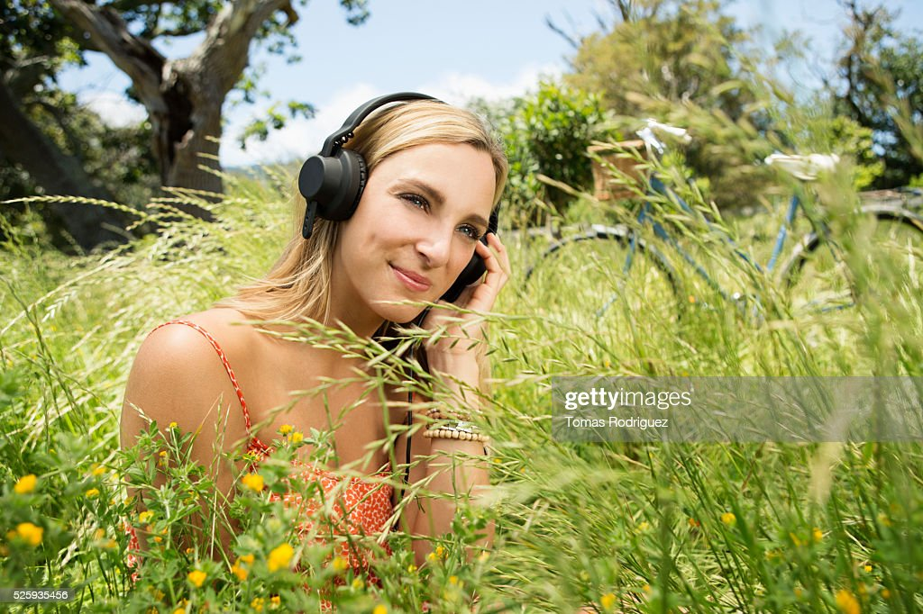 Portrait of young woman with headphones : Stock Photo