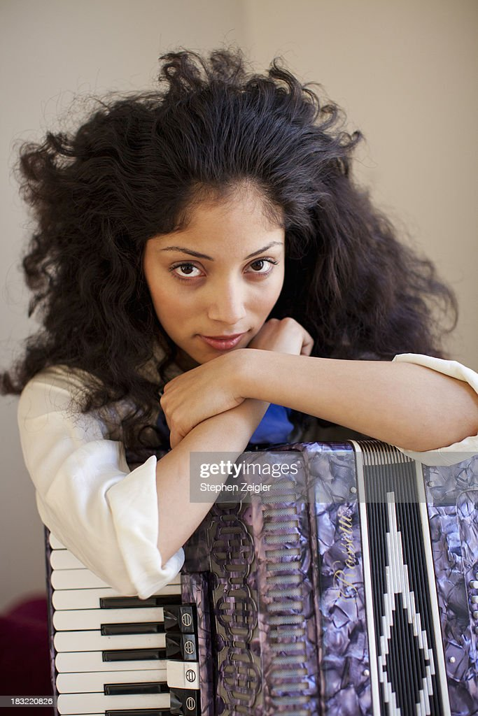 Portrait of young woman with her accordion : Stock Photo