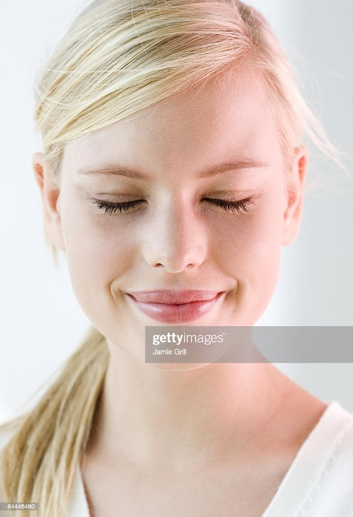 Portrait of Young woman with her eyes closed : Stock Photo
