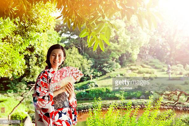 Portrait of young woman with kimono in Japanese park, Tokyo
