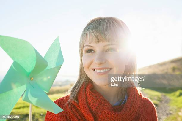 Portrait of young woman with paper windmill