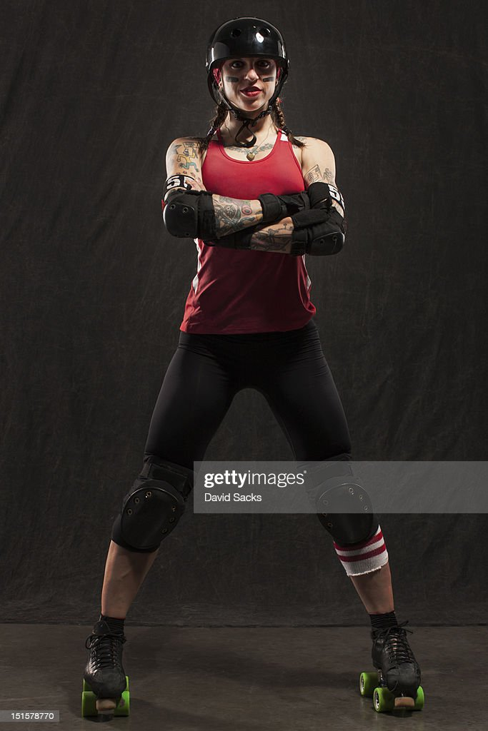 Portrait of young woman with roller derby skates : Stock Photo