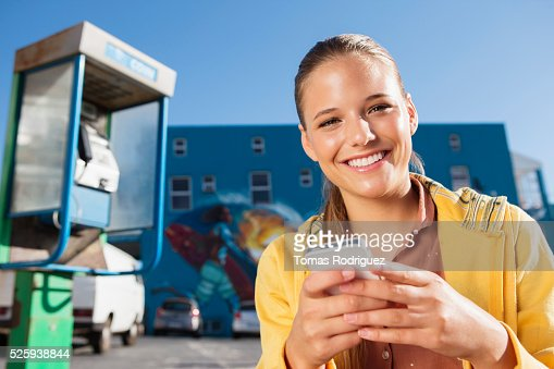 Portrait of young woman with smartphone : Stock Photo