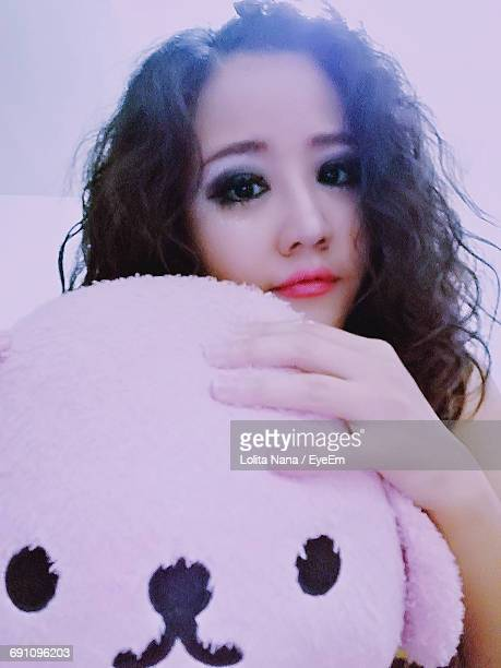 Portrait Of Young Woman With Stuffed Toy