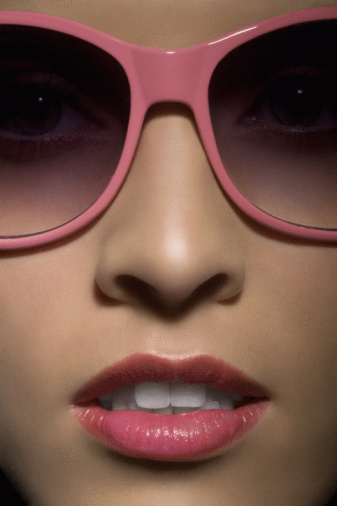 Portrait of young woman with sunglasses, close up.