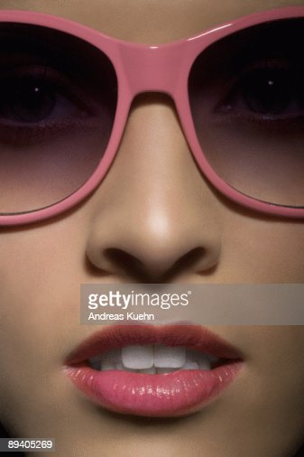 Portrait of young woman with sunglasses, close up. : Stock Photo