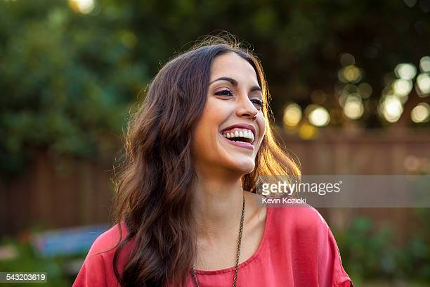 Portrait of young woman with wide smile