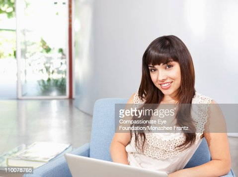 Portrait of young woman working on laptop. : Stock Photo