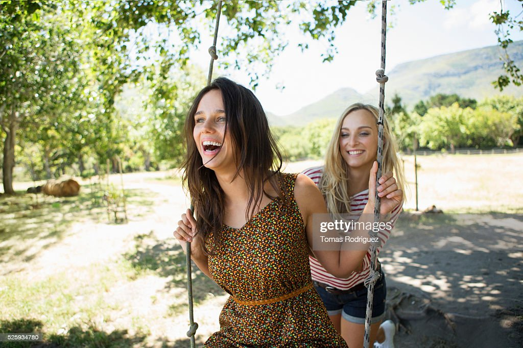 Portrait of young women on swing : Foto de stock