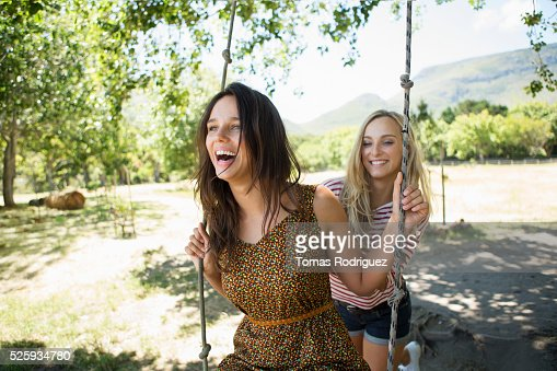 Portrait of young women on swing : Stock-Foto