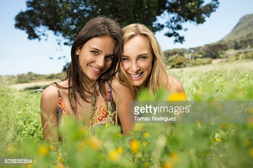 Portrait of young women relaxing at summer : Stock Photo