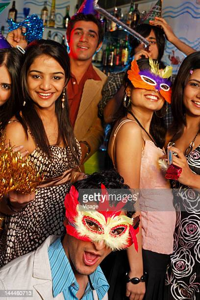 Portrait of youngsters celebrating at a party