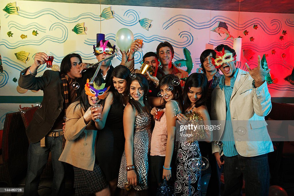 Portrait of youngsters celebrating at a party : Stock Photo