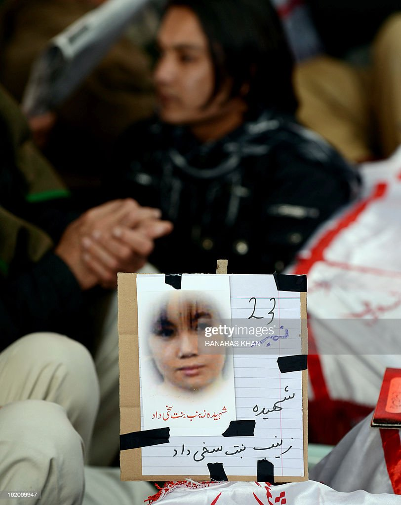 A portrait of Zainab, 23, is pictured on her coffin on the third day of protests following Saturday's bombing in Quetta on February 19, 2013, against the bombing targeted Shiite Muslims. Pakistani forces on Tuesday killed four men and arrested seven others accused of killing Shiite Muslims, including an alleged mastermind of a bomb attack that killed 89 people, officials said. AFP PHOTO/Banaras KHAN