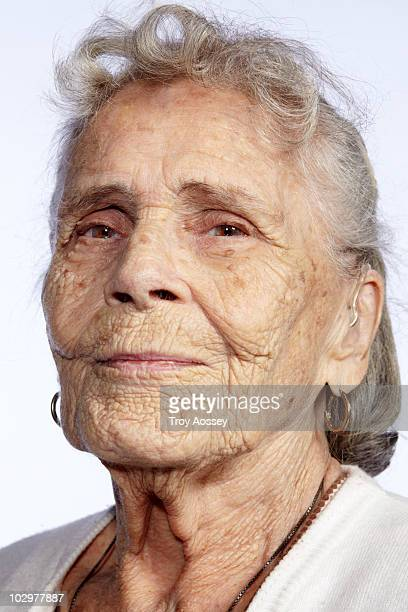 Portrait on white seamless of elderly lady smiling