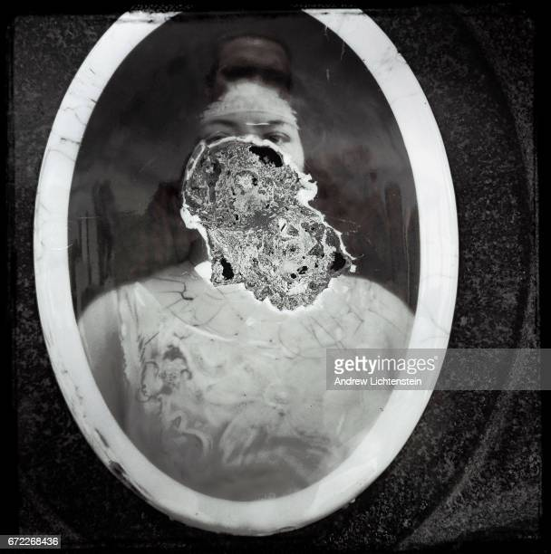 A portrait photograph of the deceased has been baked onto a porcelain plate decorating a tombstone on April 23 2017 at a Jewish cemetery in the...
