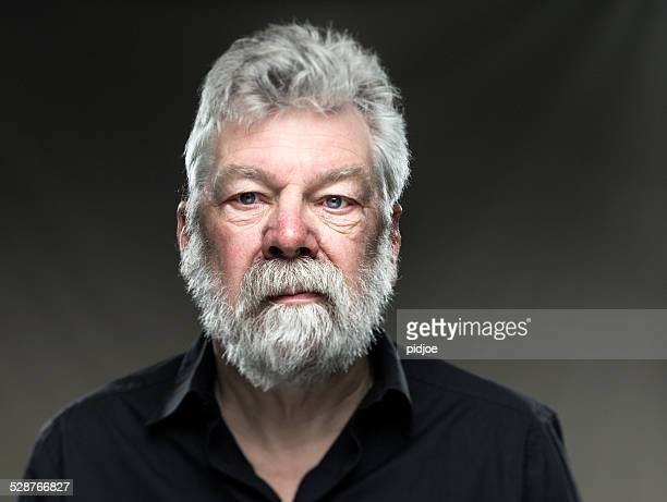 portrait real man with beard, looking straight in camera
