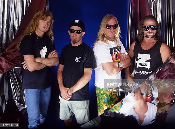 Portrait session with guitarists Dave Mustaine of Megadeath left Scott Ian Jeff Hanneman and Kerry King