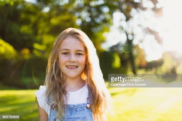 Portrait smiling girl in sunny garden