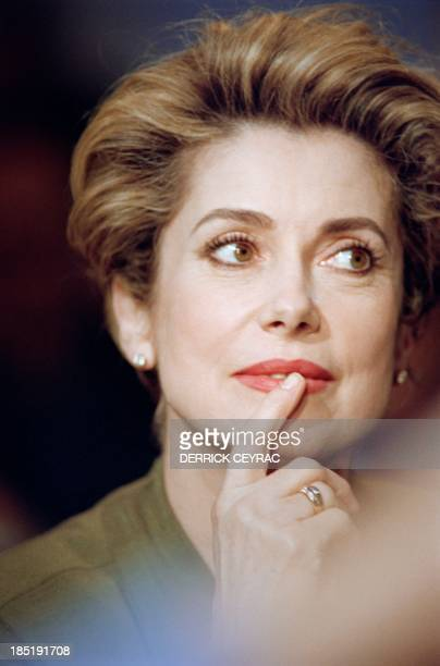 A portrait taken on April 7 1992 shows French actress Catherine Deneuve during the TV show 'Bouillon de culture' on French channel France 2 in Paris...