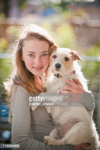 portrait, teen girl and her wire-haired terrier