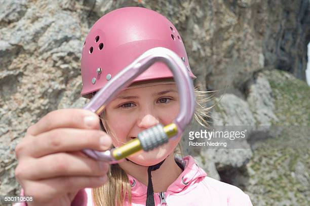 Portrait teenage girl close up holding carabiner