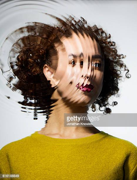 Portrait through water with ripples