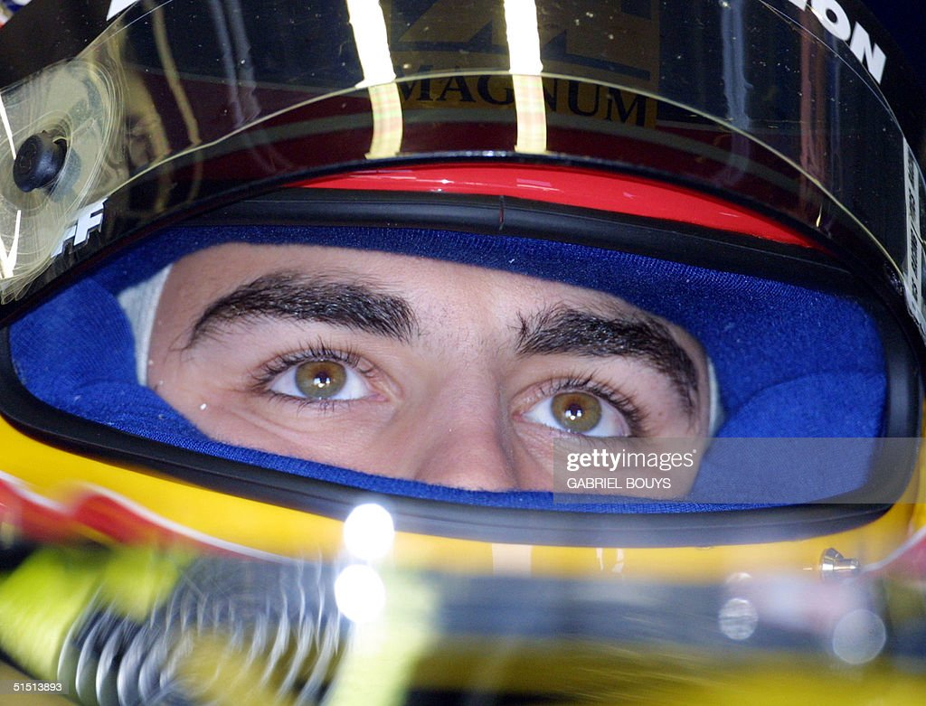 Portrait with helmet of Spanish EuropeanMinardi driver Fernando Alonso taken in the pits of the Monza racetrack during the second free practice...