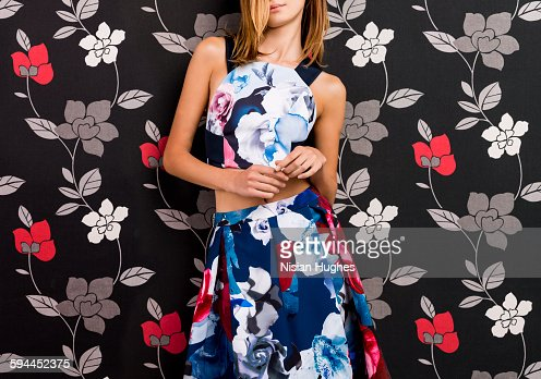 portrait woman wearing print dress on print back