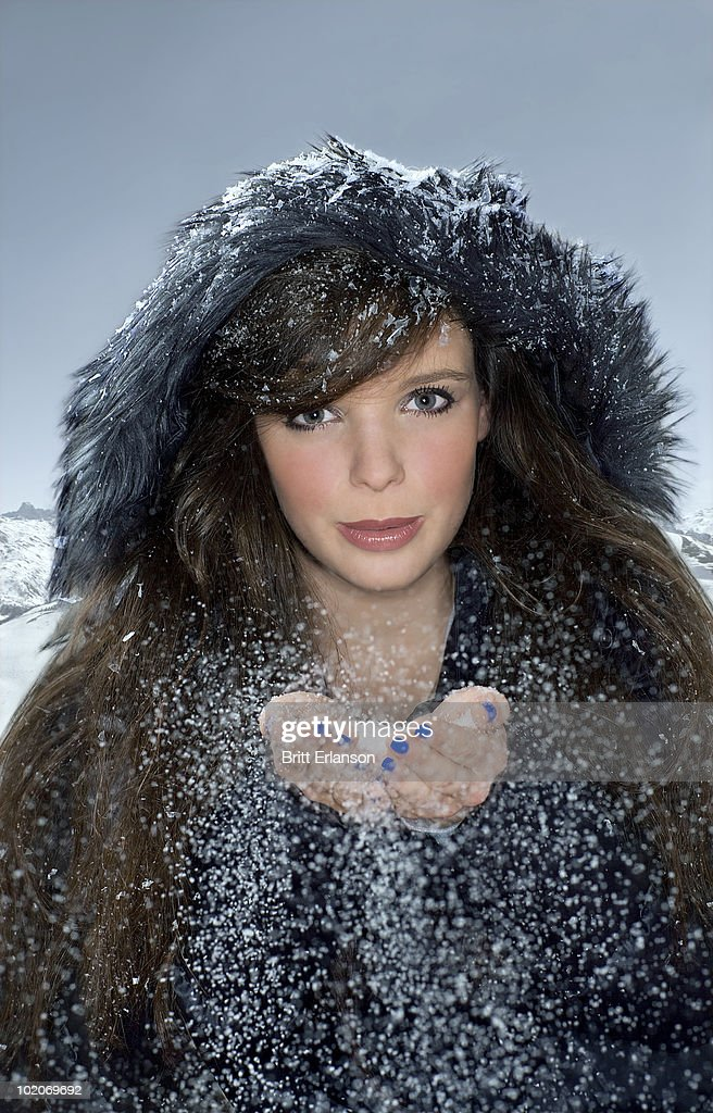 Portrait woman with snow in hands