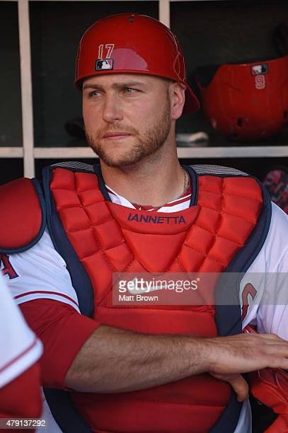 A portraitlike view of Chris Iannetta of the Los Angeles Angels of Anaheim sitting the dugout before the game against the Seattle Mariners at Angel...